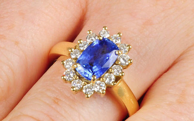 A sapphire and brilliant-cut diamond cluster ring.