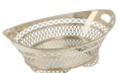 Bread basket on feet with ajour openwork side and trimmed with molded pearl edges silver.