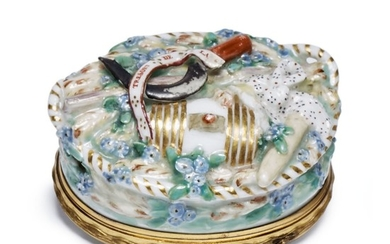 A RARE CHELSEA PORCELAIN GILT-METAL MOUNTED BONBONNIERE AND ENAMEL COVER CIRCA 1755