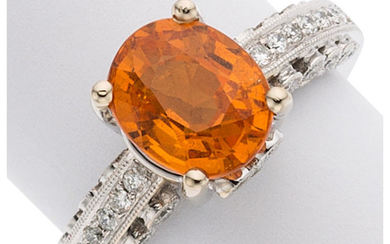 Spessartine Garnet, Diamond, White Gold Ring The ring centers...