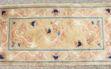 A CHINESE WOOL RUG with Dragon design in blue and