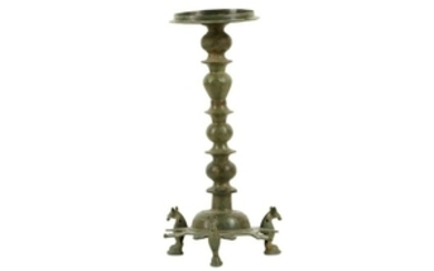 A BRONZE THREE-FOOTED OIL LAMP STAND Iran, 10th - 12th