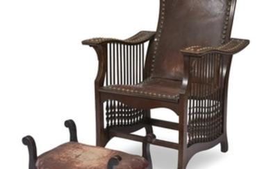 An Aesthetic Movement oak and leather armchair and footstool...