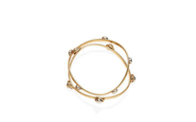 A pair of gold bangles