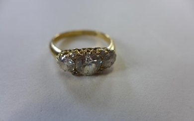 A good 18ct seven stone diamond ring, the centre stone appro...