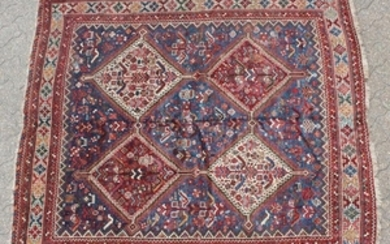 A PERSIAN QASHQAI TRIBAL RUG with four large diamond