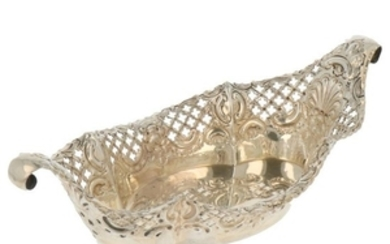 Bonbon basket in boat shape with curled ends, with casted rocailles decoration silver.