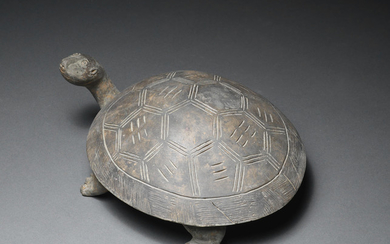 A grey pottery tortoise-shaped ink-stone and cover