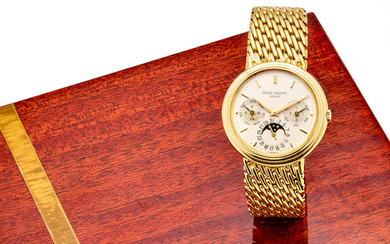 Patek Philippe. A fine 18K gold automatic bracelet watch with perpetual calendar and moon phase
