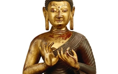 A MAGNIFICENT AND RARE LARGE IMPERIAL KASHMIR-STYLE PARCEL-GILT LACQUER COPPER ALLOY FIGURE OF SHAKYAMUNI BUDDHA QING DYNASTY, QIANLONG PERIOD