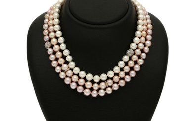 A three string pearl necklace set with numerous cultured freshwater pearls. Spacers set with numerous brilliant-cut brown diamonds, mounted in 14k white gold.