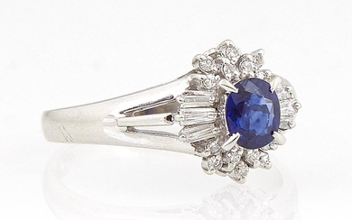 Lady's Platinum Dinner Ring, with a central oval .43