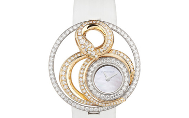 BOUCHERON AJOURÉE AMVARA In Sanskrit, « amvara » means infinite space. An endlessly entwined snake carved in volume around the white gold case and set with diamonds is here to symbolize this idea.,