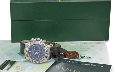ROLEX. A VERY FINE AND RARE 18K WHITE GOLD AUTOMATIC CHRONOGRAPH WRISTWATCH WITH SODALITE DIAL, ORIGINAL GUARANTEE AND BOX, SIGNED ROLEX, OYSTER PERPETUAL, COSMOGRAPH, DAYTONA, REF. 116519, CASE NO. D716177, CIRCA 2006