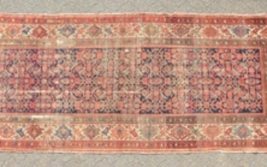 A PERSIAN MAHAL CARPET with a long blue and red central