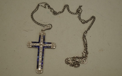 A diamond and sapphire encrusted unmarked cross pendant, hav...