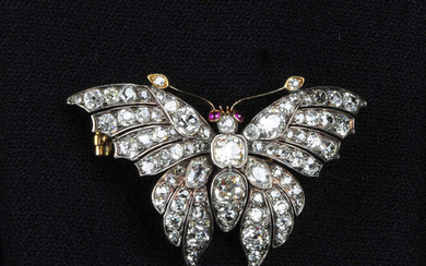A late Victorian silver and gold, old-cut diamond butterfly brooch, with ruby eyes.
