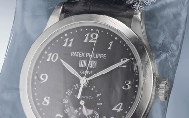 Patek Philippe, Ref. 5396G An elegant and attractive white gold limited edition automatic wristwatch with center seconds, annual calendar, 24-hour indication, inverted moonphases, black luminous dial with Breguet numerals, commemorative engraved back...