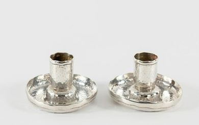 Tiffany & Co., a pair of planished silver candlesticks,