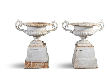 A PAIR OF VICTORIAN CAST IRON URNS, of compressed …
