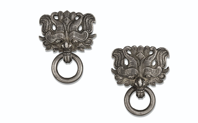 A PAIR OF SILVER TAOTIE-MASK HANDLES, EASTERN HAN-SIX DYNASTIES PERIOD, 3RD-4TH CENTURY AD