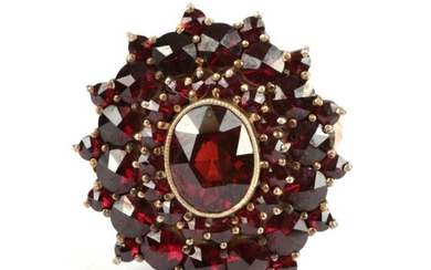 A Garnet Cluster Ring, with three rows of rose cut...