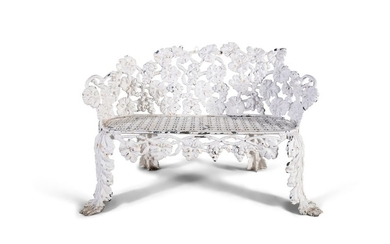 A VICTORIAN CAST IRON GARDEN BENCH, formed by frui…