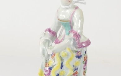 A Bow Porcelain Figure of a Girl, circa 1765, standing...