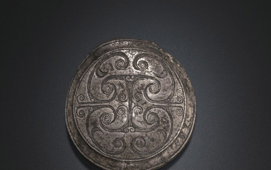 A CIRCULAR SILVER HARNESS FITTING, WARRING STATES PERIOD, 4TH CENTURY BC