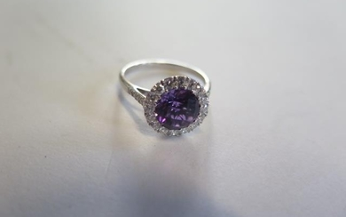 An 18ct white gold amethyst and diamond ring, size N approx ...
