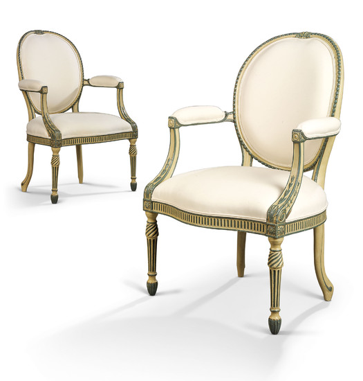 A PAIR OF GEORGE III GREEN AND CREAM-PAINTED OPEN ARMCHAIRS, ATTRIBUTED TO MAYHEW AND INCE, CIRCA 1774