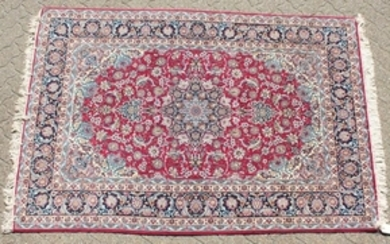 A FINE PERSIAN SILK AND WOOL ISFAHAN CARPET