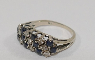 A sapphire and diamond dress ring, the nine small round bril...