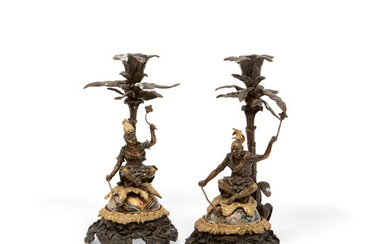 A pair of Continental parcel gilt bronze articulated figural candlesticks