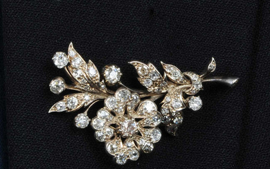 An early 20th century silver and gold old-cut diamond floral spray brooch.