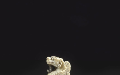 A GREYISH-WHITE JADE CARVING OF A MYTHICAL WINGED BEAST, MING DYNASTY, 17TH CENTURY