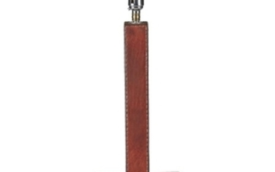 A stitched red leather table lamp In the manner...