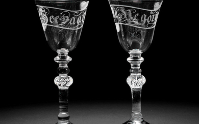 A rare pair of Dutch engraved light baluster wine glasses, circa 1760