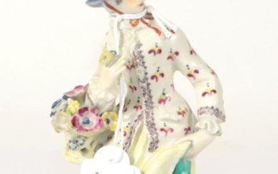 A Bow Porcelain Figure of a Lady, circa 1760, standing...