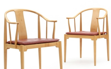 "Hans J. Wegner: ""China Chair"". A pair of armchairs of cherry wood. Seat cushion upholstered with red leather. (2)"