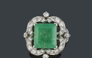 Diamond ring with central emerald