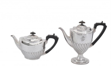 A Victorian silver oval pedestal tea pot and coffee pot by Elkington & Co.