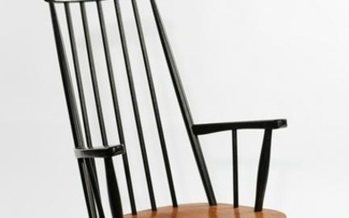 Style of Ilmair Tapiovaara, a rocking chair, with