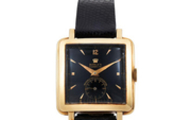 Rolex. A Yellow Gold Perpetual Chronometer Square Wristwatch with Black Dial
