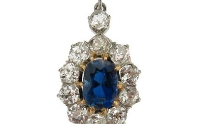 A sapphire and diamond cluster pendant, the oval-shaped...