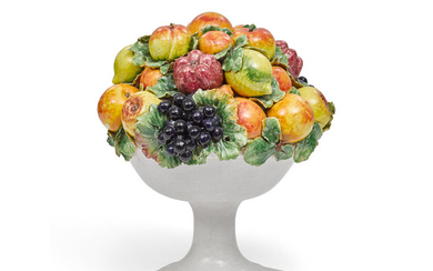 A Continental faience fruit-filled bowl