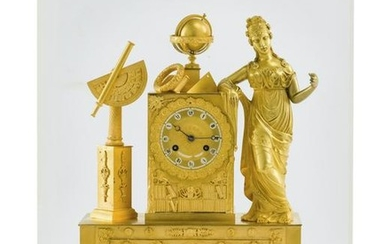 A French Charles X gilt-bronze figural clock