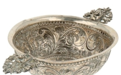 Brandy bowl around decorated with Dutch scenes on both sides complemented with rocailles and leaf motifs. Openwork handles with putti heads silver.