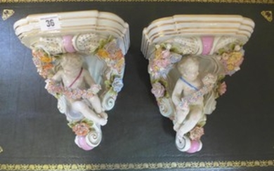 A pair of floral encrusted porcelain brackets - 27cm tall - ...