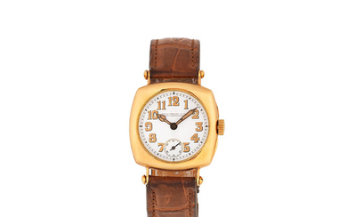 Patek Philippe. An early 18K gold manual wind cushion form officer's style wristwatch with enamel dial